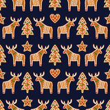 Seamless pattern with Christmas gingerbread cookies - xmas tree, star, heart, deer. Stock Photography