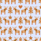 Seamless pattern with Christmas gingerbread cookies - Xmas tree, star, heart, deer. Winter holiday vector Xmas design on blue background Stock Photo