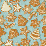 Seamless pattern with Christmas gingerbread in vintage style on christmas tree background. Royalty Free Stock Photo
