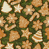 Seamless pattern with Christmas gingerbread in vintage style on christmas tree background. Royalty Free Stock Images