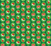 Seamless Pattern with Christmas Icons Gloves, Hats and Socks Iso. Seamless Pattern with Christmas Icons Gloves, Hats and Socks  on Green Background Royalty Free Stock Photos