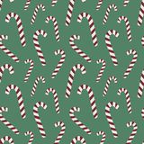 Seamless pattern for Christmas and New Year. Hand-drawn vector illustration of candy canes on a green background. vector illustration