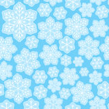 Seamless pattern with Christmas snowflakes. On blue Royalty Free Stock Image