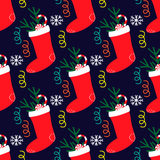Seamless pattern with christmas sock with sweets Stock Photography
