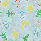 Seamless pattern christmas symbols on blue paper Royalty Free Stock Images