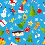 Seamless pattern of Christmas symbols. In flat style on light blue background Royalty Free Stock Photo