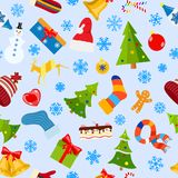 Seamless pattern of Christmas symbols. And warm winter clothes in flat style on white background Royalty Free Stock Photo