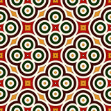 Seamless pattern in Christmas traditional colors. Abstract background with bright geometric ornament. Royalty Free Stock Photos