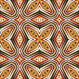 Seamless pattern in Christmas traditional colors. Bright ornamental abstract background. Ethnic and tribal motifs. Stock Photos