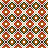 Seamless pattern in Christmas traditional colors. Repeated squares and rhombuses bright ornamental abstract background. Stock Images