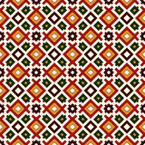 Seamless pattern in Christmas traditional colors. Repeated squares and rhombuses bright ornamental abstract background. Stock Photo