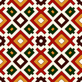 Seamless pattern in Christmas traditional colors. Repeated squares and rhombuses bright ornamental abstract background. Royalty Free Stock Photos