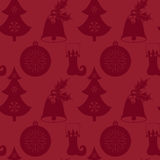 Seamless pattern with Christmas tree, bell, stocking and ball. Flat elements on a red background. Vector illustration. It can be used for design of packing Royalty Free Stock Photo