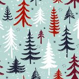 Seamless pattern with Christmas tree. Winter forest. Vector background. Stock Photos