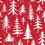 Seamless pattern with Christmas tree. Stylized winter forest. Vector background. Seamless pattern with Christmas tree and snowflakes on red background. Stylized Stock Photography
