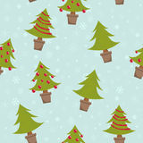 Seamless pattern with christmas trees. Winter seamless pattern with christmas trees in pots and toys Royalty Free Stock Images