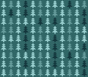 Seamless pattern with christmas trees on blue background Stock Images