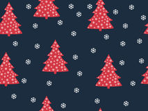 Seamless pattern. Christmas trees and snowflakes on a red backgr Stock Photo