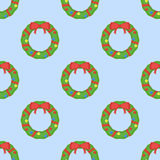 Seamless pattern with Christmas wreath on blue background. Vector texture Stock Photo