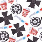 Seamless pattern with cinema accessories as 3d glasses, film bobbin, popcorn basket, spotlight on white background. Repeat design. For wrapping paper and Royalty Free Stock Photos