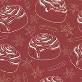 Seamless pattern with cinnamon rolls with frosting and spice. Stock Images