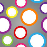 Seamless pattern of circles. Seamless pattern made of cute and fun white circles with colorful borders over gradient grey background Stock Images