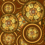Seamless pattern. Circles with decorative swirls. Drawn by hand. Vector background in brown and gold Stock Photography