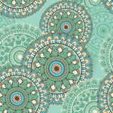 Seamless pattern with circular floral ornament. Floral background with mandalas for the greeting cards, invitation, business style, cards, textile backgrounds Royalty Free Stock Images