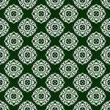 Seamless pattern with circular white ornament on a green background. Vector Stock Photography