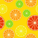 Seamless pattern with citrus mix. Seamless pattern with citrus fruits on yellow background. Orange, grapefruit, lemon, lime. Vector Stock Photos