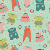 Seamless pattern with clothes for babies Royalty Free Stock Photos