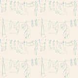 Seamless pattern with clothes. Stock Photos