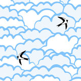 Seamless pattern with clouds and birds. Royalty Free Stock Images