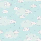 Seamless pattern with clouds and birds Royalty Free Stock Image
