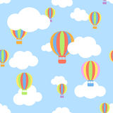 Seamless pattern with clouds and different colors cartoon aerost Royalty Free Stock Photos