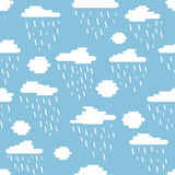 Seamless pattern, clouds and rain created of rounded lines. Rainy day on blue sky Royalty Free Stock Images