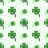 Seamless pattern with clover leaves. Simple vector illustration. stock illustration