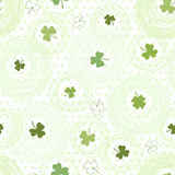 Seamless pattern with clover on the  polka dots background Royalty Free Stock Image