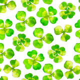 Seamless pattern with clover, watercolor illustrated background. stock illustration