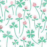 Seamless pattern with clovers and flowers Royalty Free Stock Photography