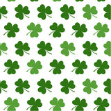 Seamless pattern with clovers leaves for design of St. Patricks Day items Royalty Free Stock Images