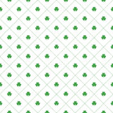 Seamless pattern with clovers leaves and stripes in rhomb shape for design of St. Patricks Day items. Royalty Free Stock Photography