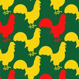Seamless pattern with cocks. Bright seamless pattern with cocks on the green background Stock Photography