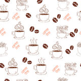 Seamless pattern with coffee cups and beans. Royalty Free Stock Image