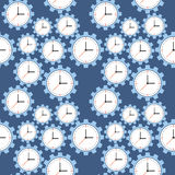 Seamless pattern. Cogwheels and clocks over blue background. Royalty Free Stock Photography