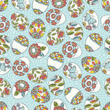 Seamless  pattern with color easter eggs, flowers and butterfly. Stock Image