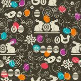 Seamless  pattern with color easter eggs, rabbit,  flowers Royalty Free Stock Photography