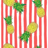 Seamless pattern color pineapple at an angle on coral strips stock images