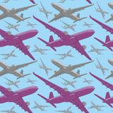 Seamless pattern of colored airliners Royalty Free Stock Photos