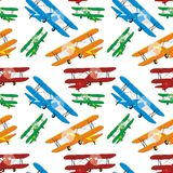 Seamless pattern of colored airplanes Royalty Free Stock Photo